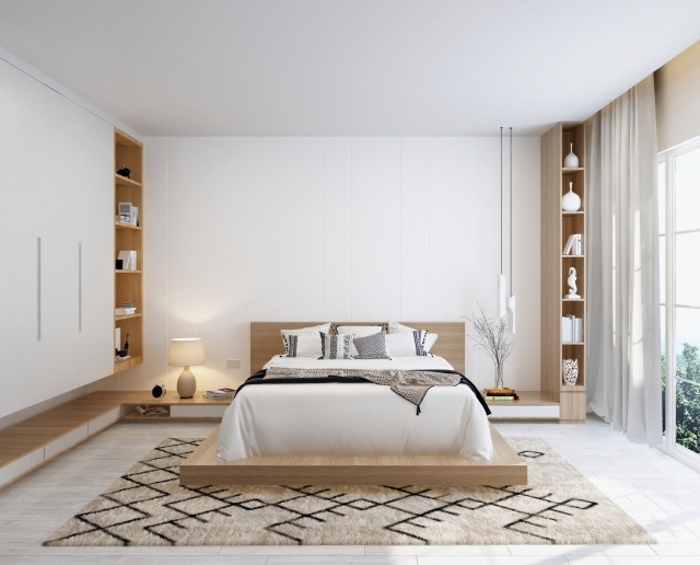 大きめサイズ、ヘッドボード付きの木製のベッドを使う